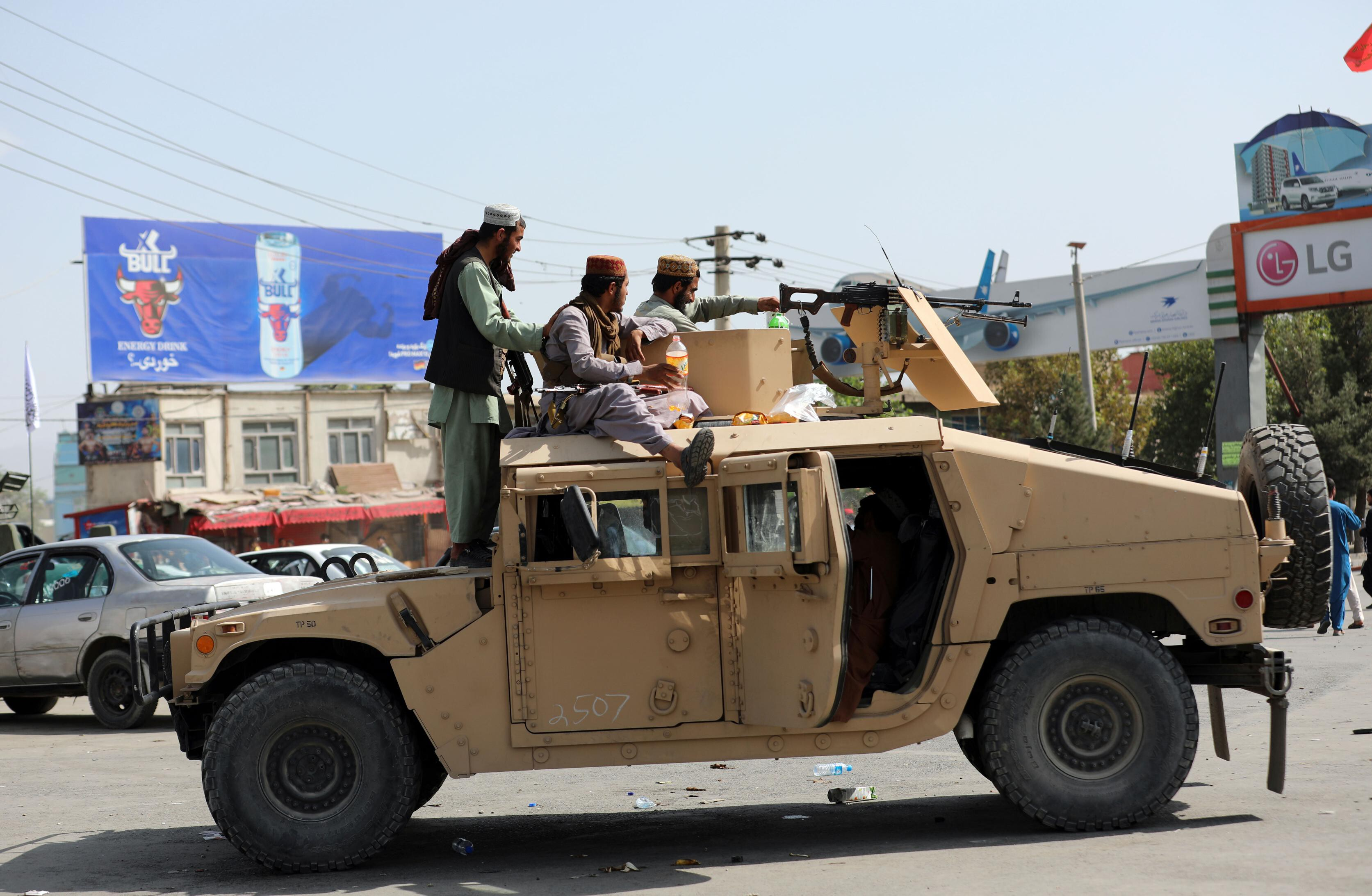 Rifles, Humvees and millions of rounds of ammo: Taliban celebrate their new American arsenal