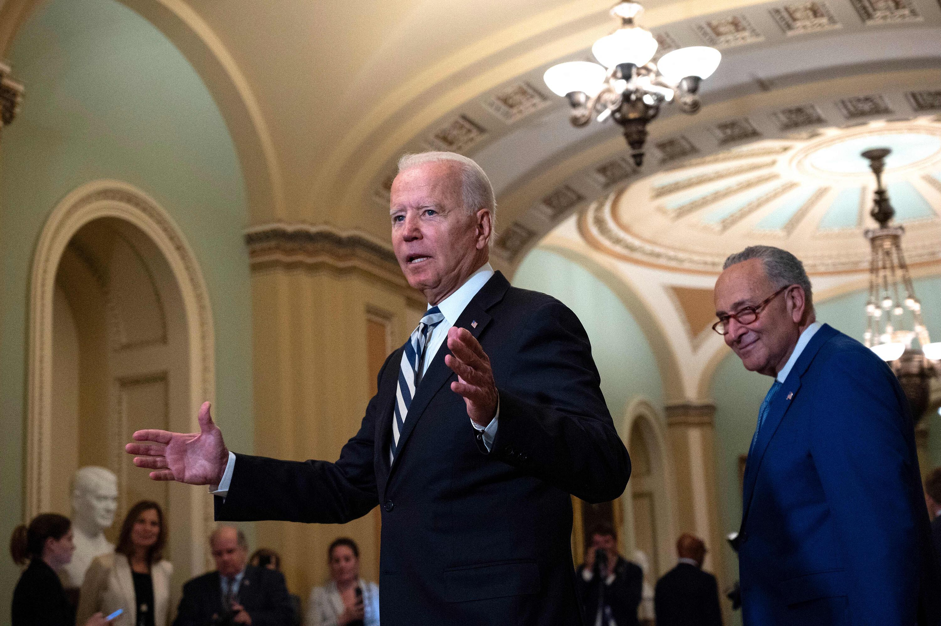 Biden goes all in to try to defuse Democrat-on-Democrat war with his agenda on the brink