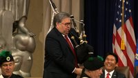 Barr strikes playful chord with bagpipes performance at Justice event