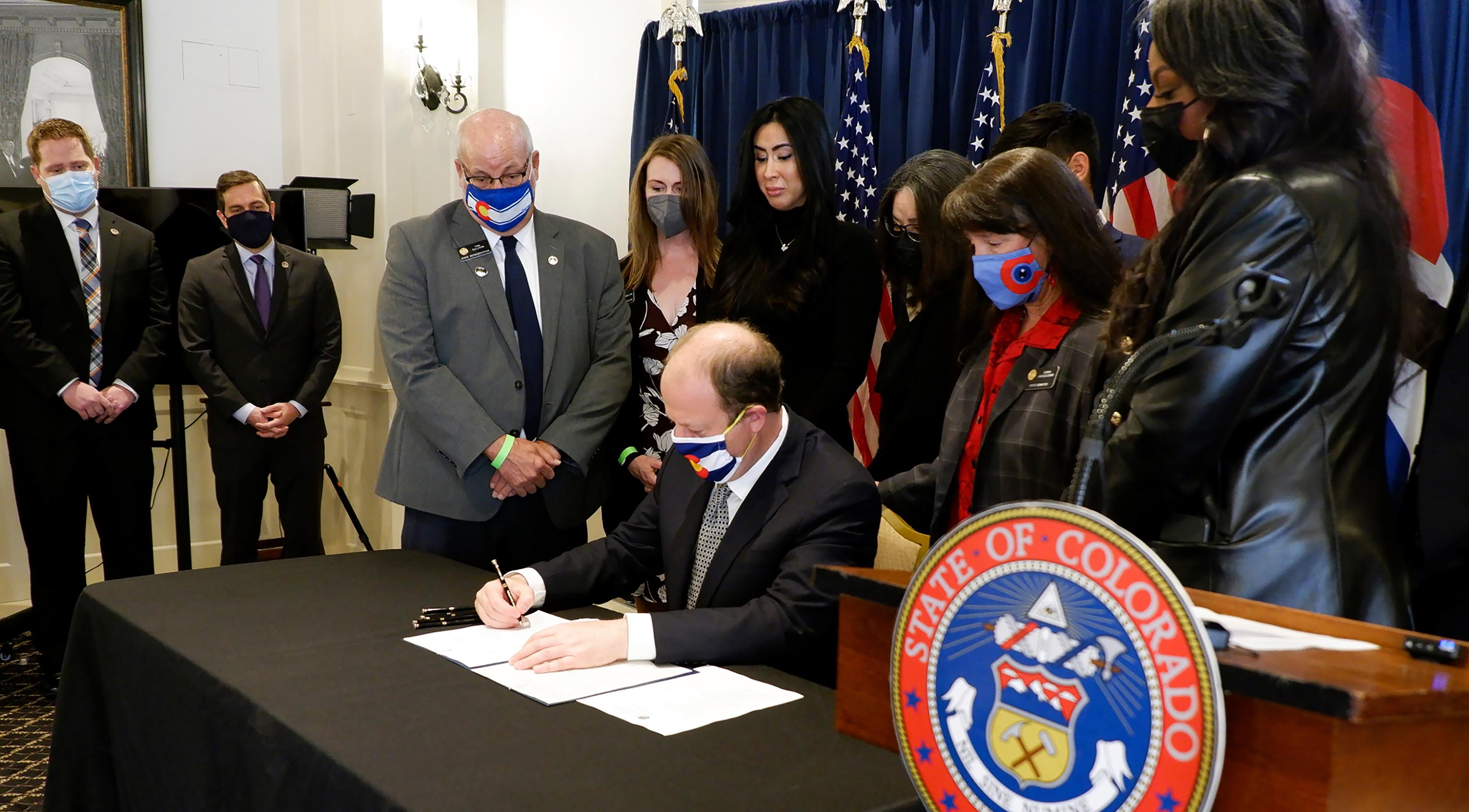 Colorado governor signs two gun measures into law nearly a month after Boulder shooting