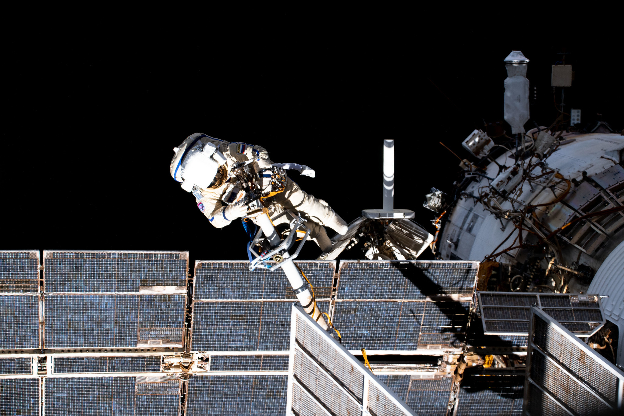 Russian cosmonauts conduct spacewalk despite smoke, alarm on space station