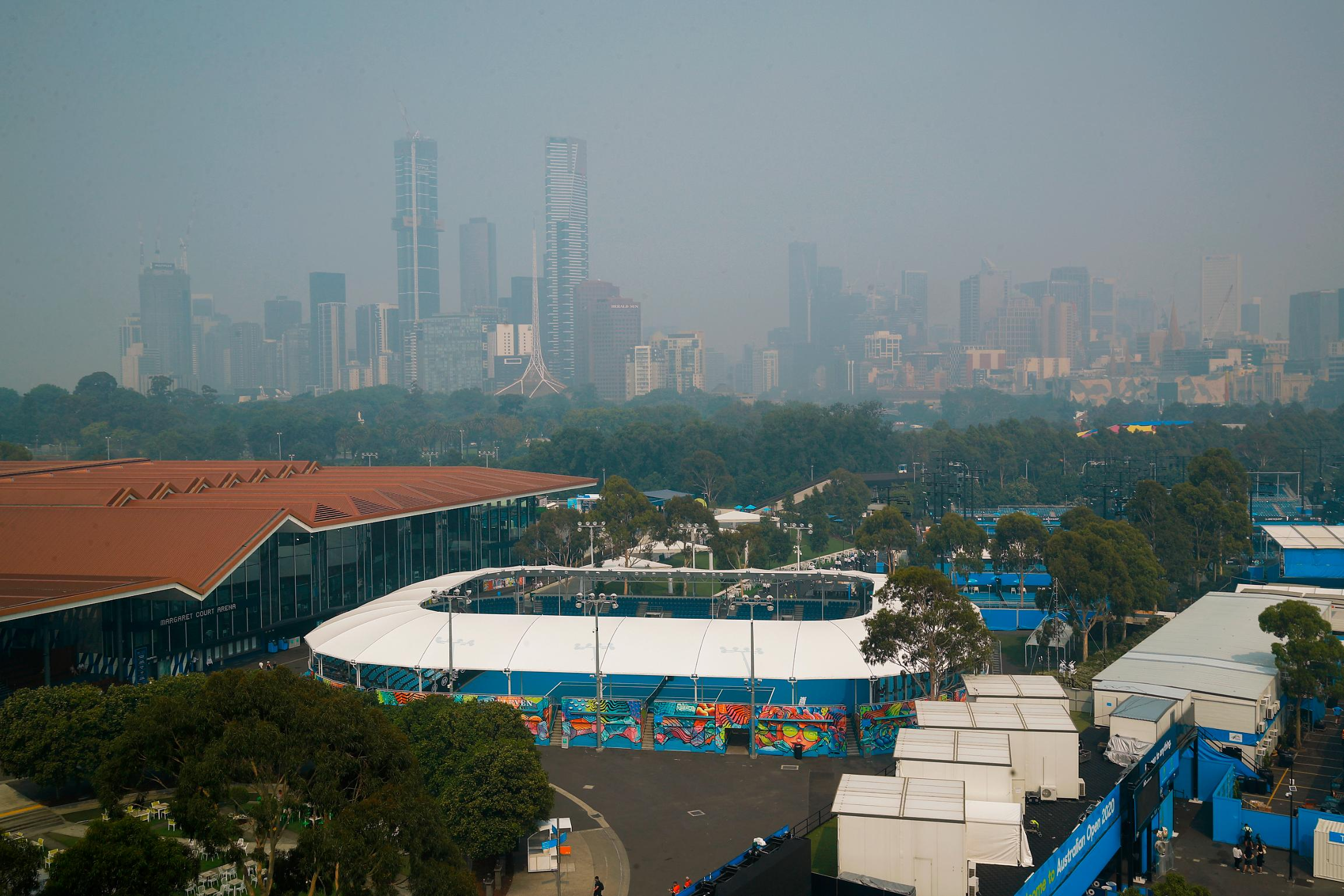Australian Open chief says tournament will go ahead despite air quality concerns