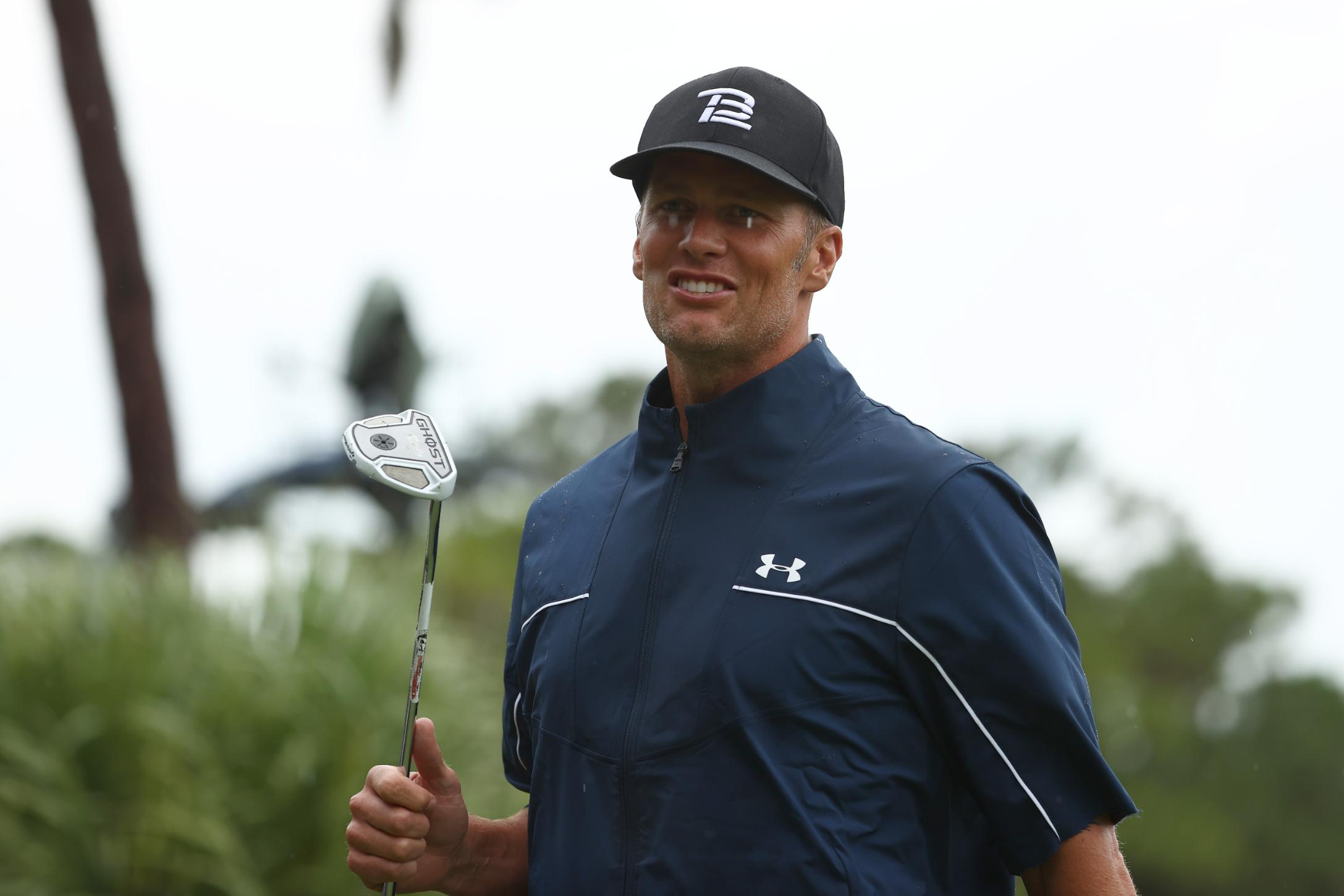 Tom Brady shows he's human as Tiger Woods backs up trash talk at 'Champions for Charity' golf match