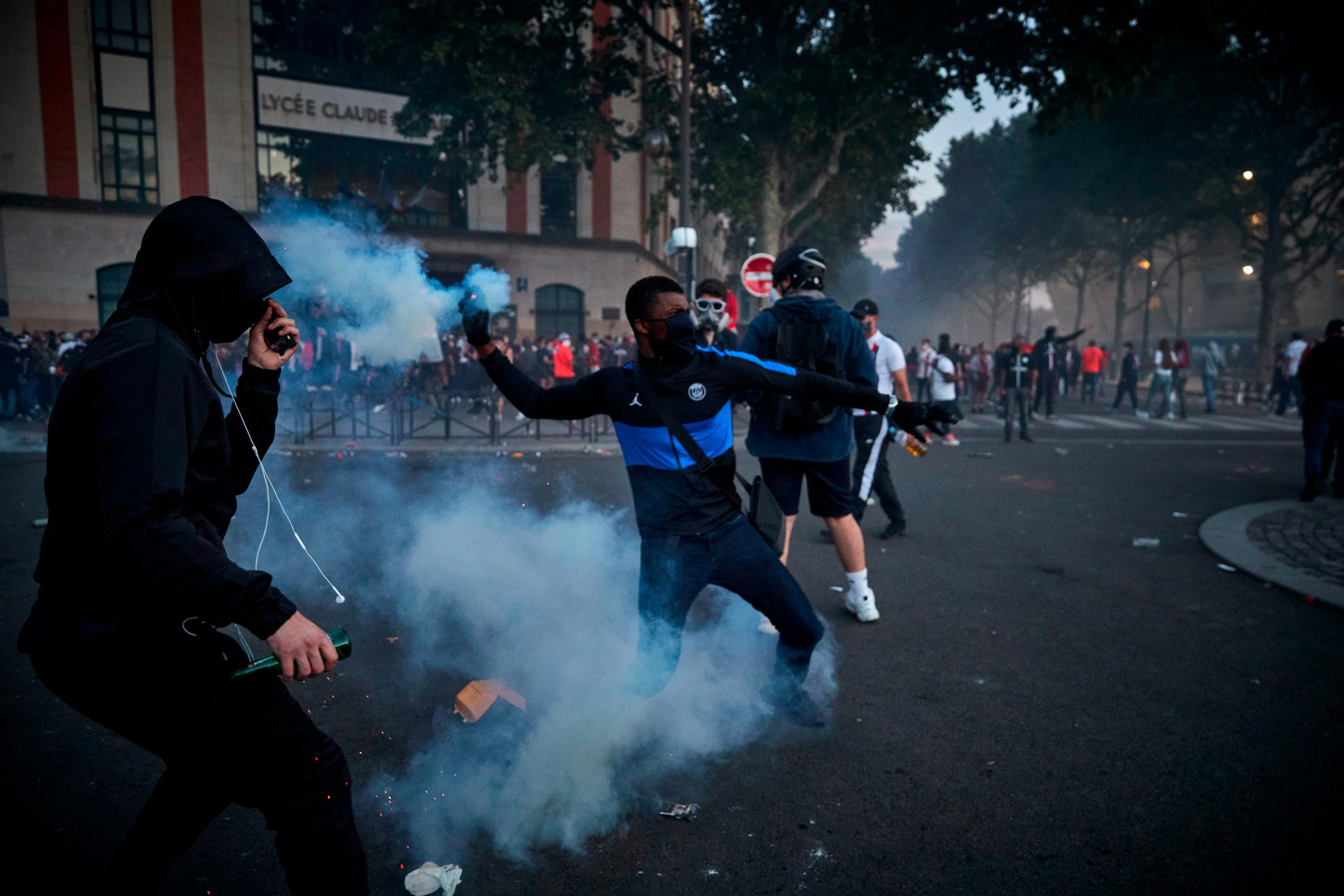 148 arrested as fans clash with riot police in Paris after PSG's Champions League final defeat