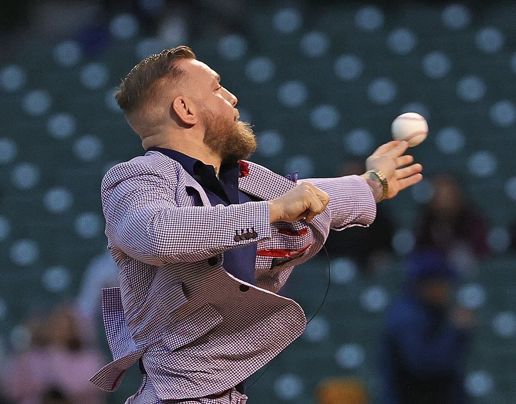 Conor McGregor's ceremonial first pitch at the Cubs game was … out there