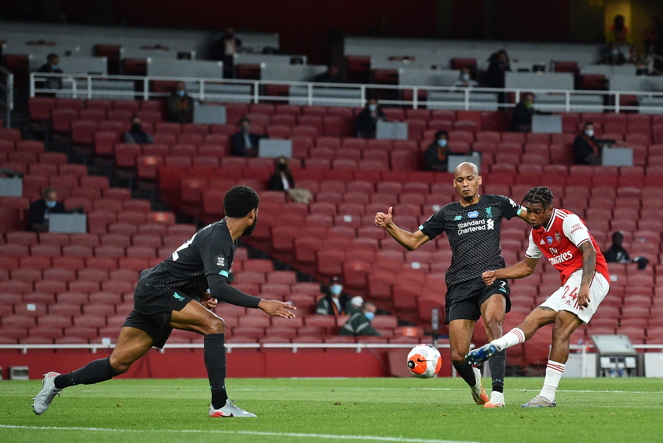 Errors end Liverpool's record points chase with defeat at Arsenal