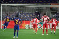 Lionel Messi scores 700th career goal in style but Barcelona loses more ground in title race