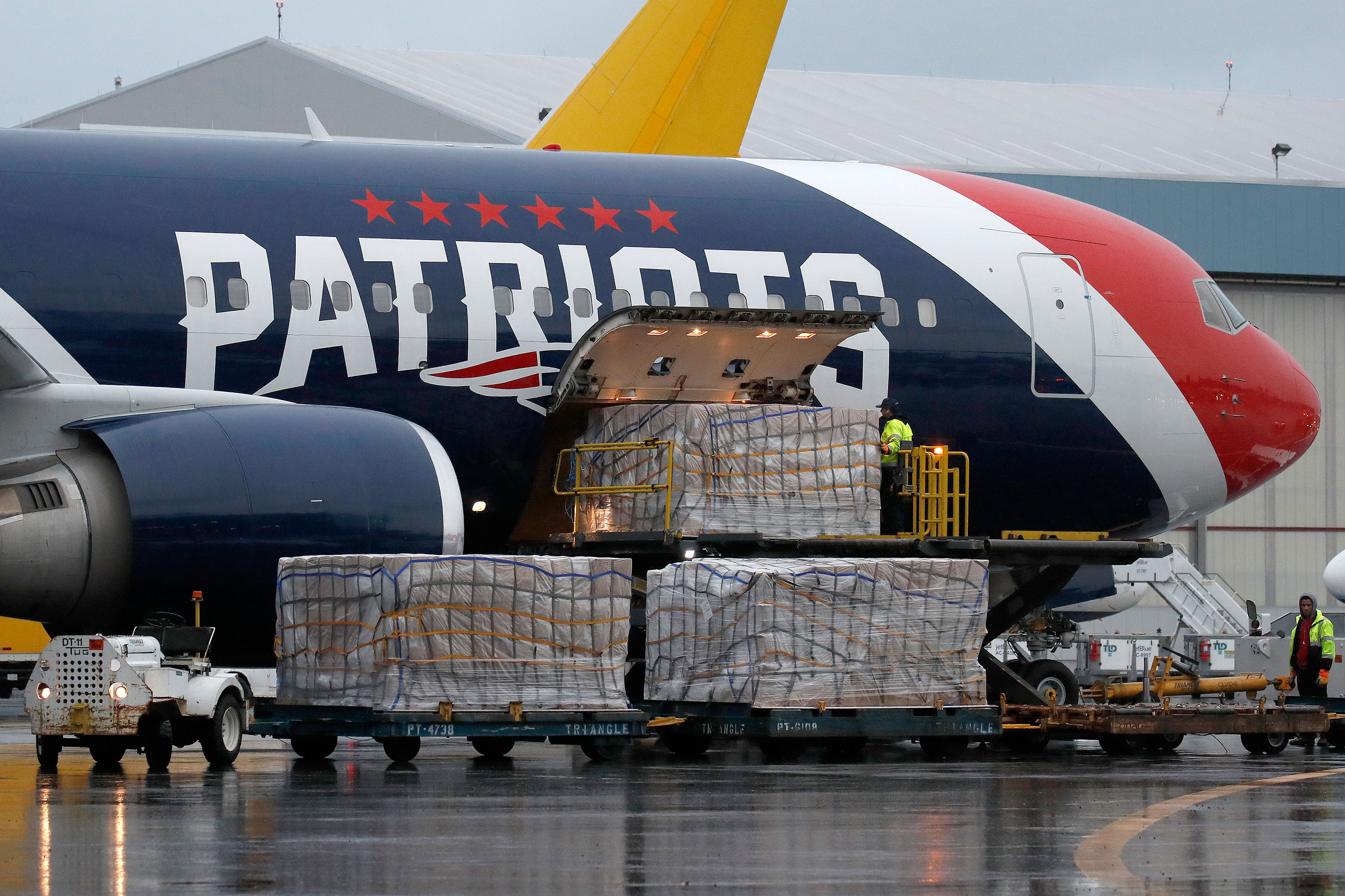 New England Patriots fly 1.2 million protective masks from China after 'challenging' operation