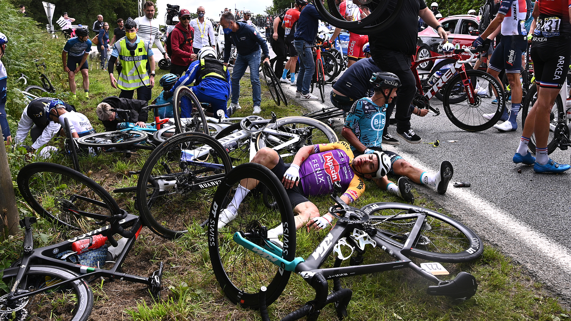 French authorities open investigation after Tour de France spectator causes massive crash