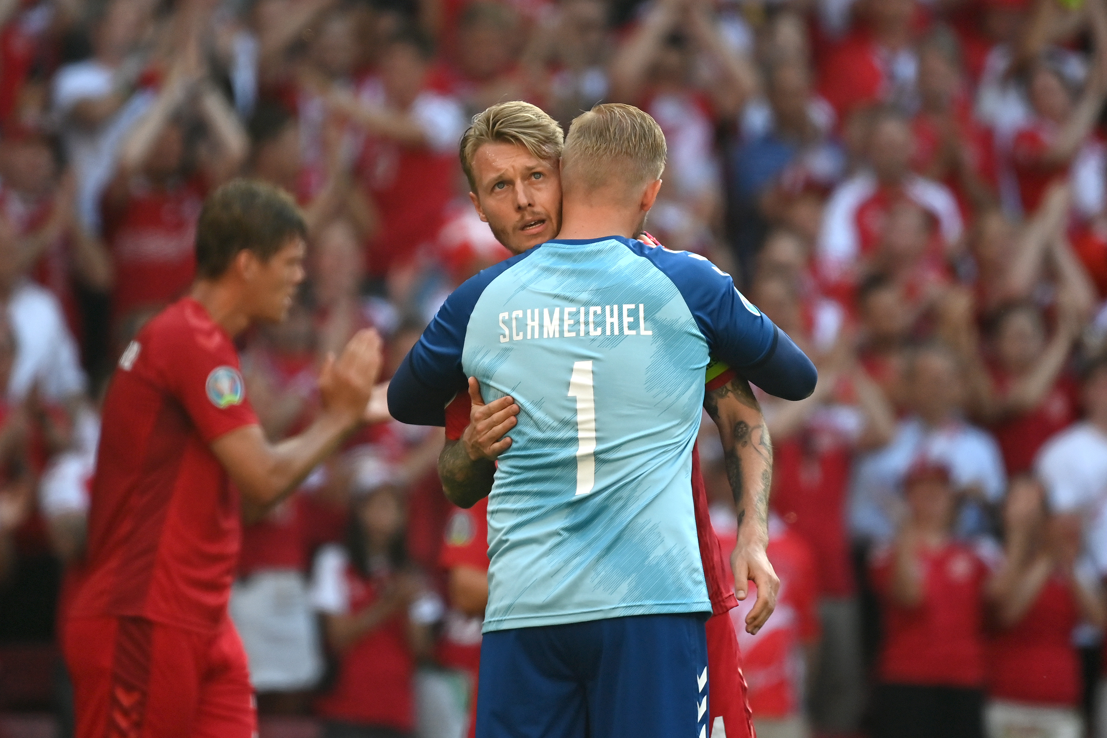 Euro 2020: Denmark and Belgium pause match as minute's applause held for Christian Eriksen