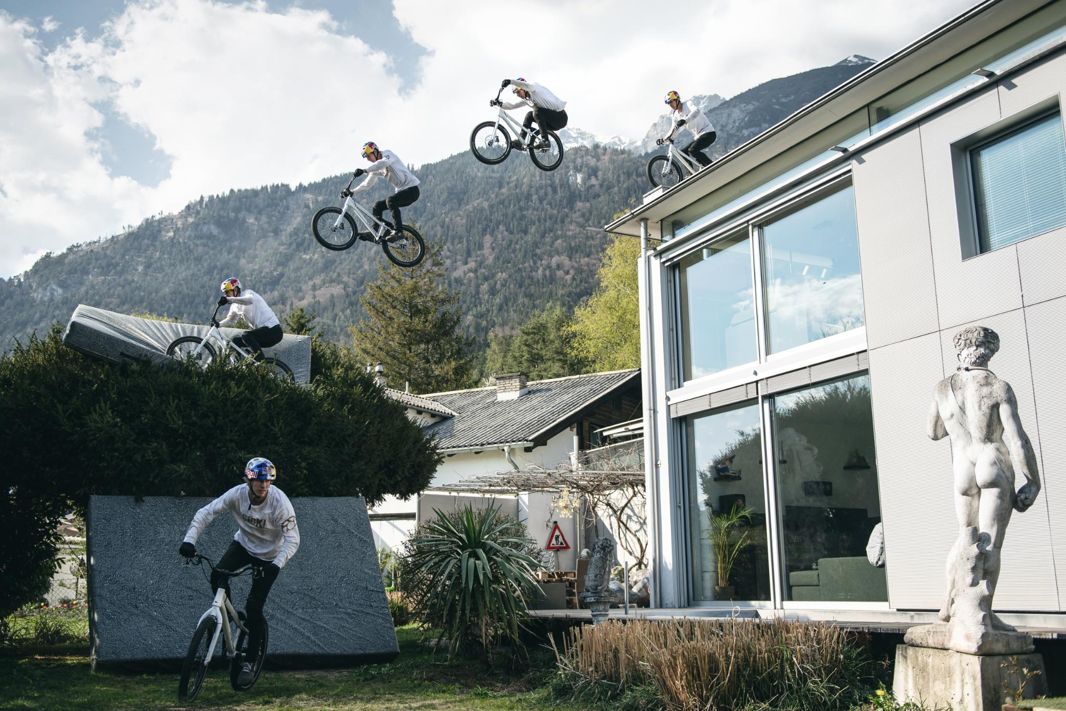 Daredevil biker Fabio Wibmer swaps mountains for washing machine stunts