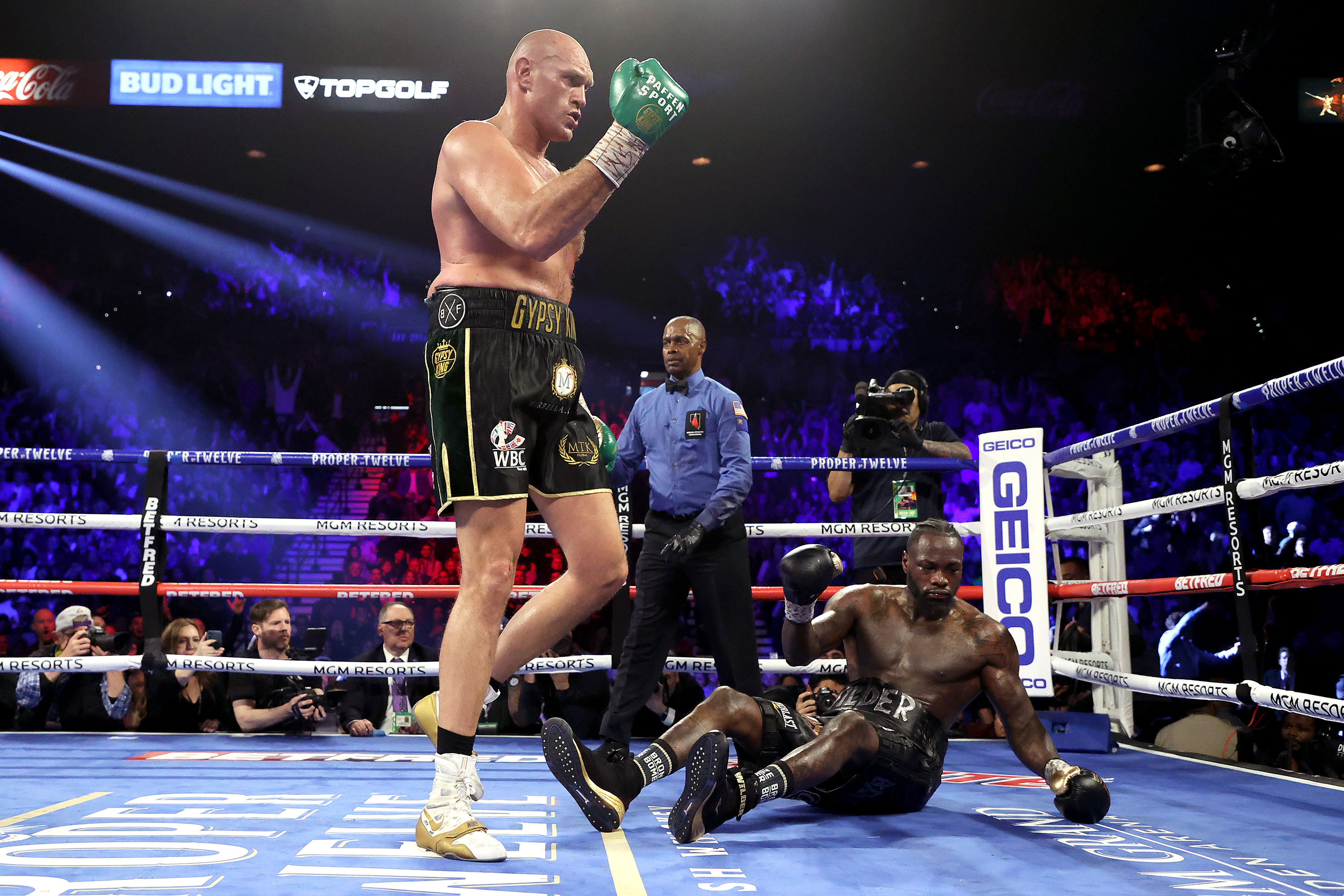 Tyson Fury stops Deontay Wilder in seventh round of WBC heavyweight title rematch