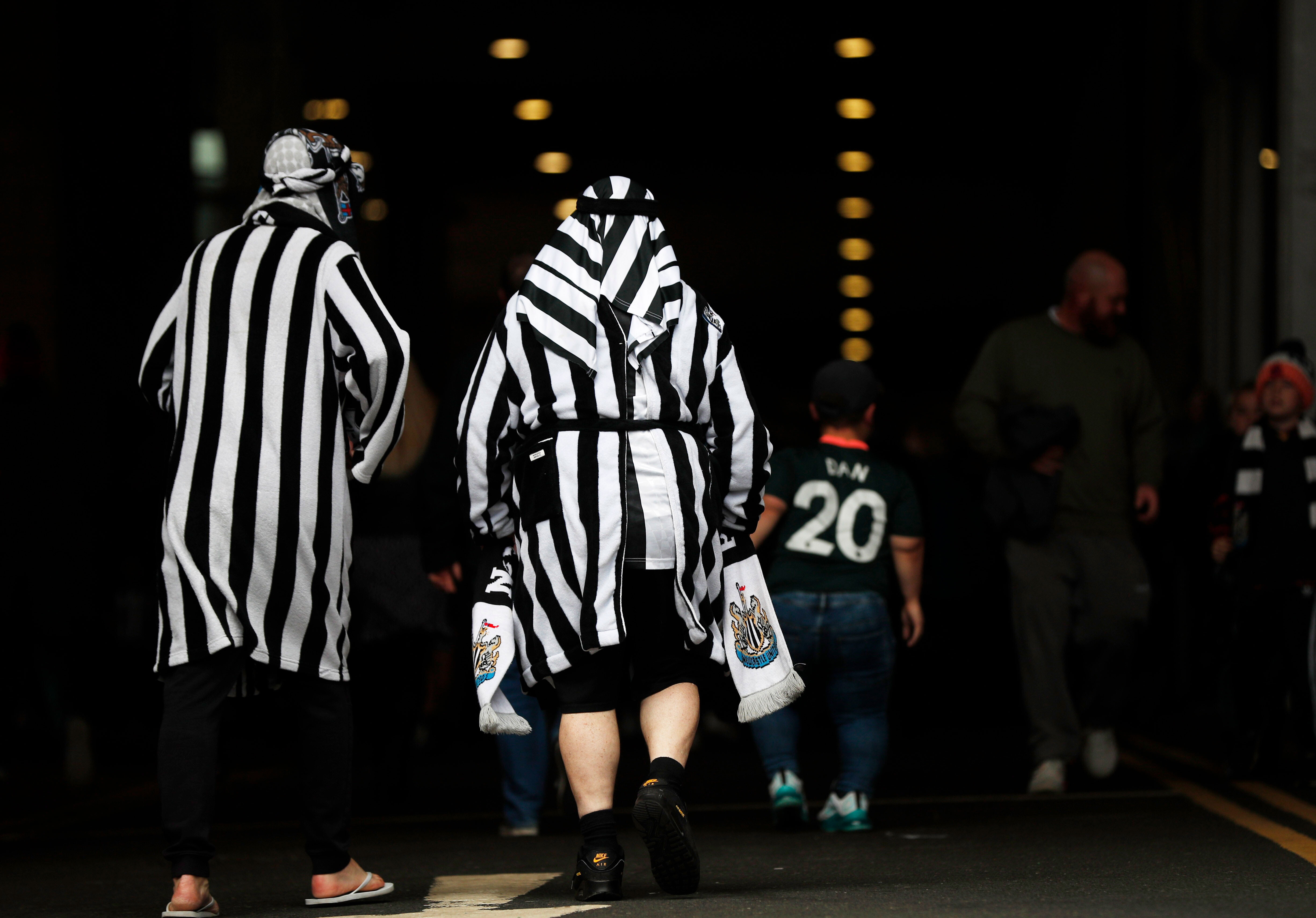 Newcastle United urges fans to not wear mock Arab head coverings following Saudi takeover