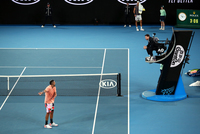 'Are you stupid?' Nick Kyrgios rages at umpire over bleeding hand during victory at Australian Open