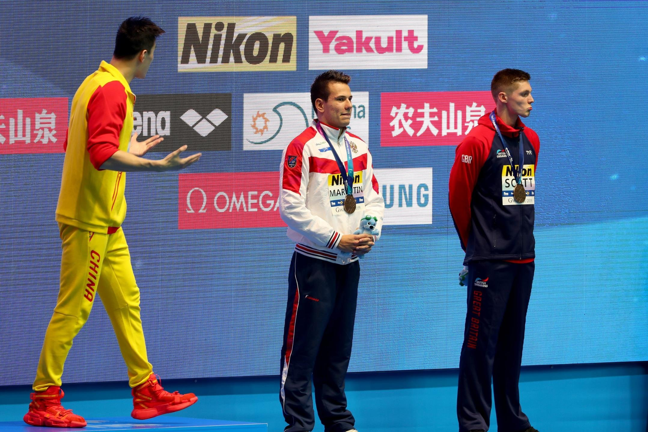 Controversial swimming star Sun Yang reacts angrily after opponent refuses to share podium