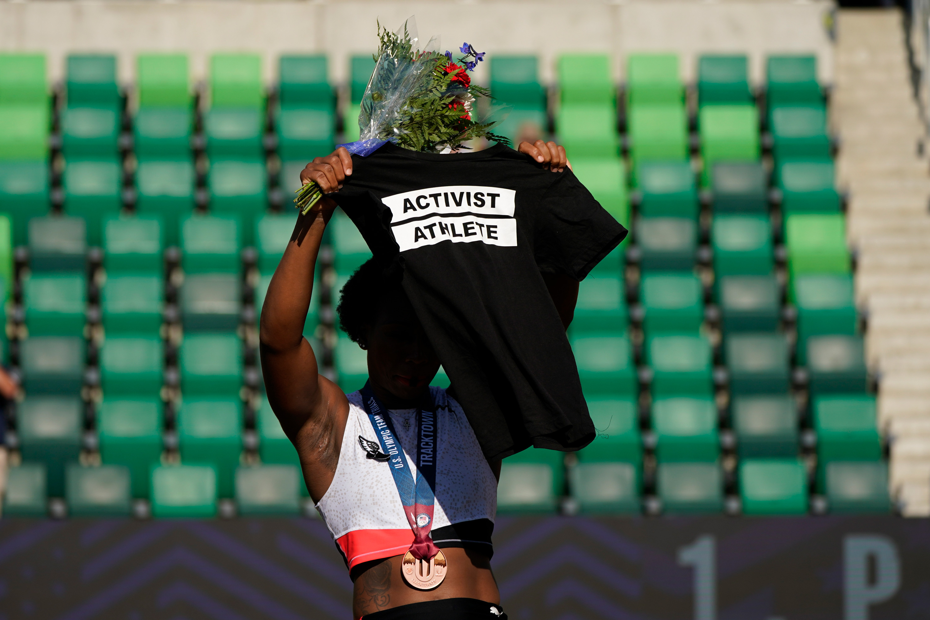 'I never said that I hated the country,' says US hammer thrower Gwen Berry after turning from the flag