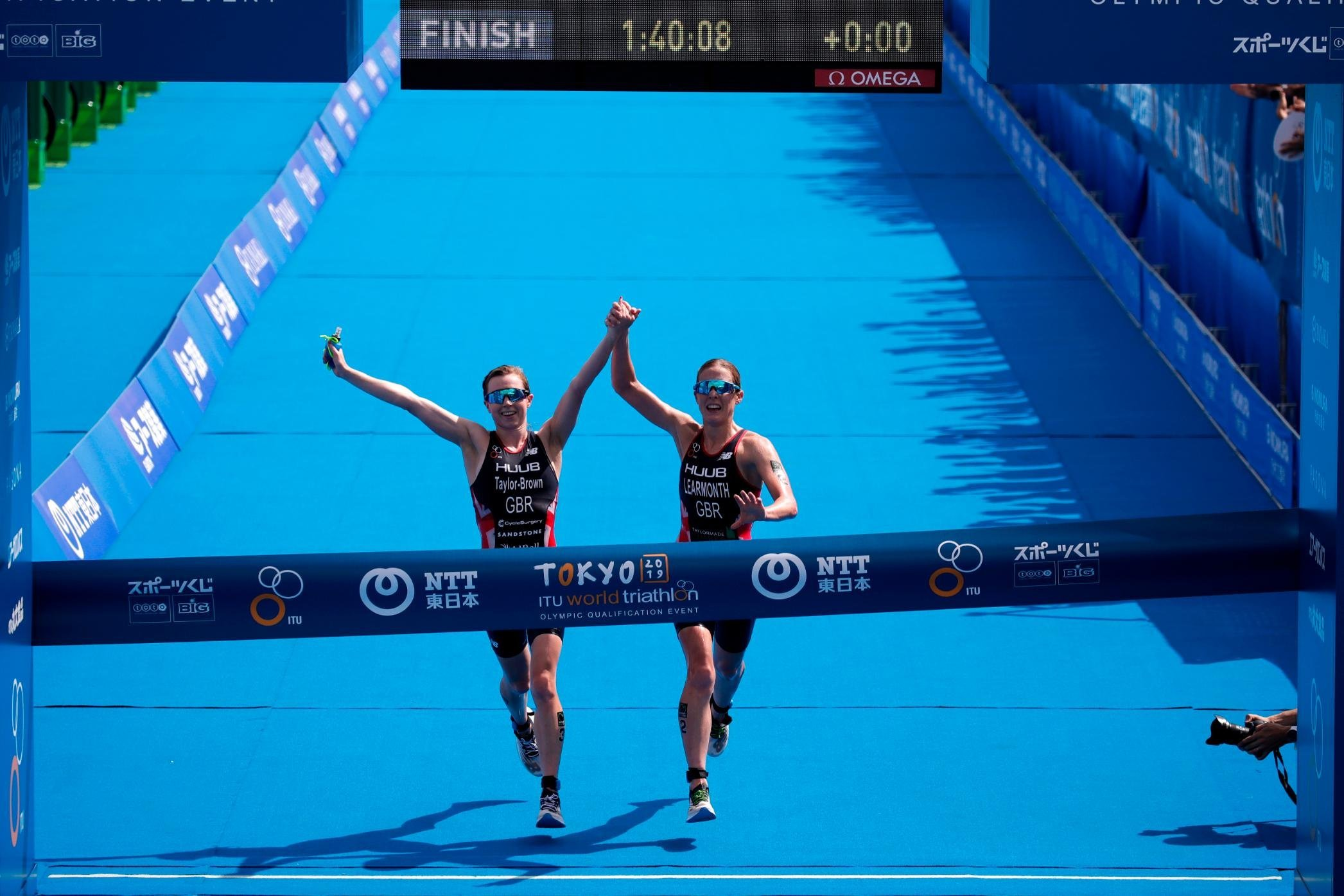 Triathletes disqualified from Olympics warm-up race for crossing finishing line hand-in-hand