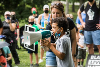 An 8-year-old boy organized a Black Lives Matter march for kids. Hundreds showed up.