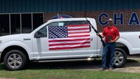 An Alabama car dealership is giving away bibles, flags and 12-gauge shotguns in honor of the Fourth of July