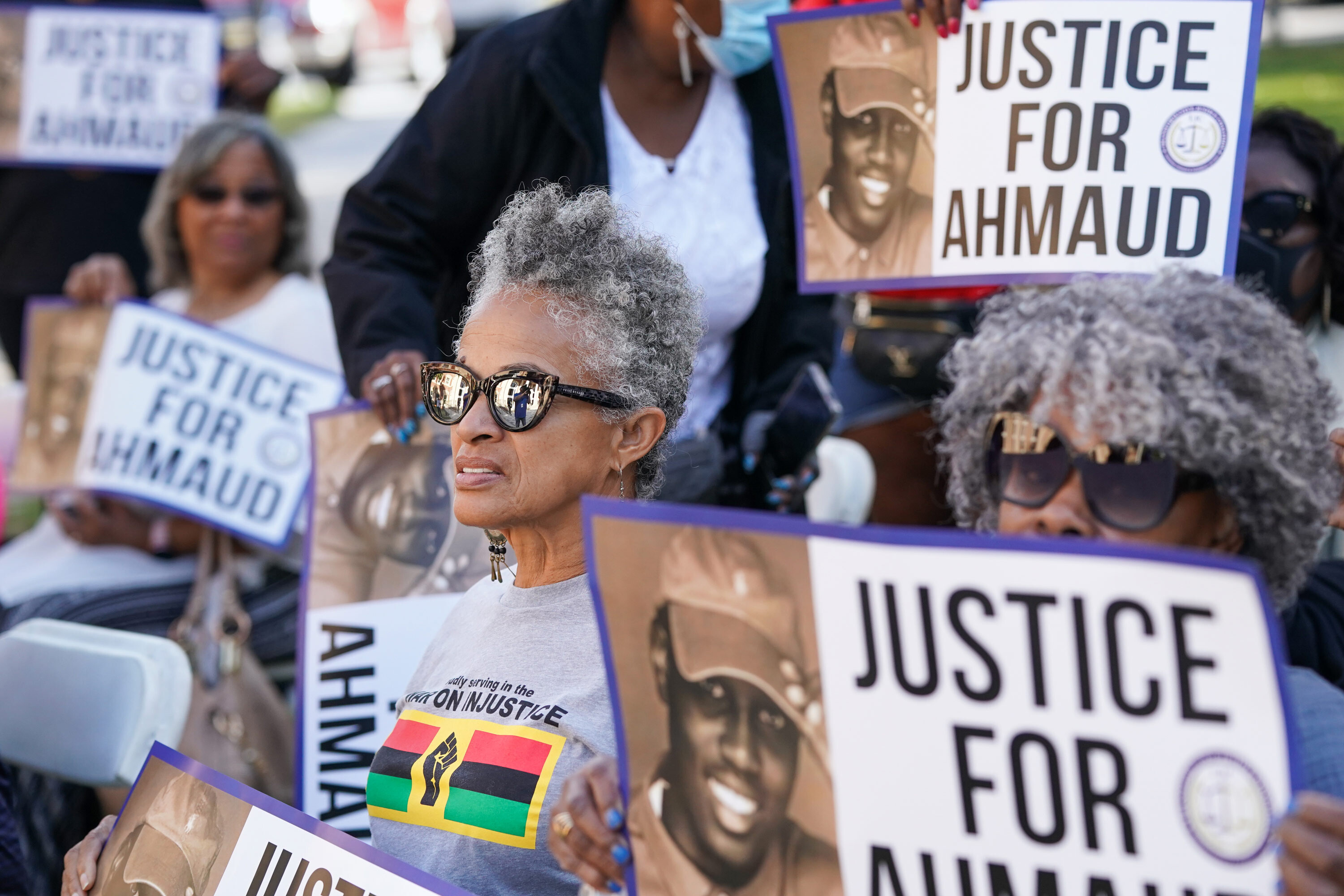 As the trial for Ahmaud Arbery's killing starts, activists from across the country are showing up to support him and his family
