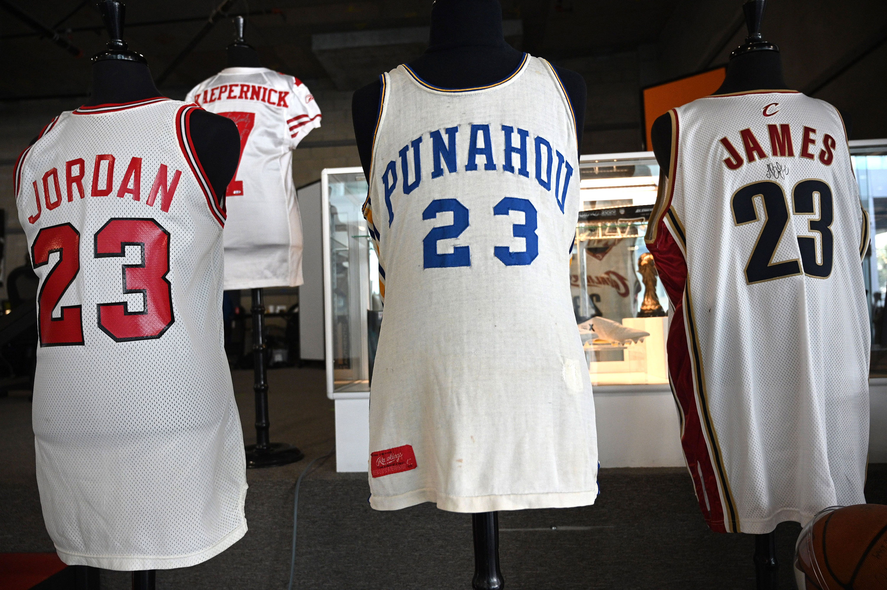 Jerseys bearing the last names of Jordan, Kaepernick and Obama break records in online auction