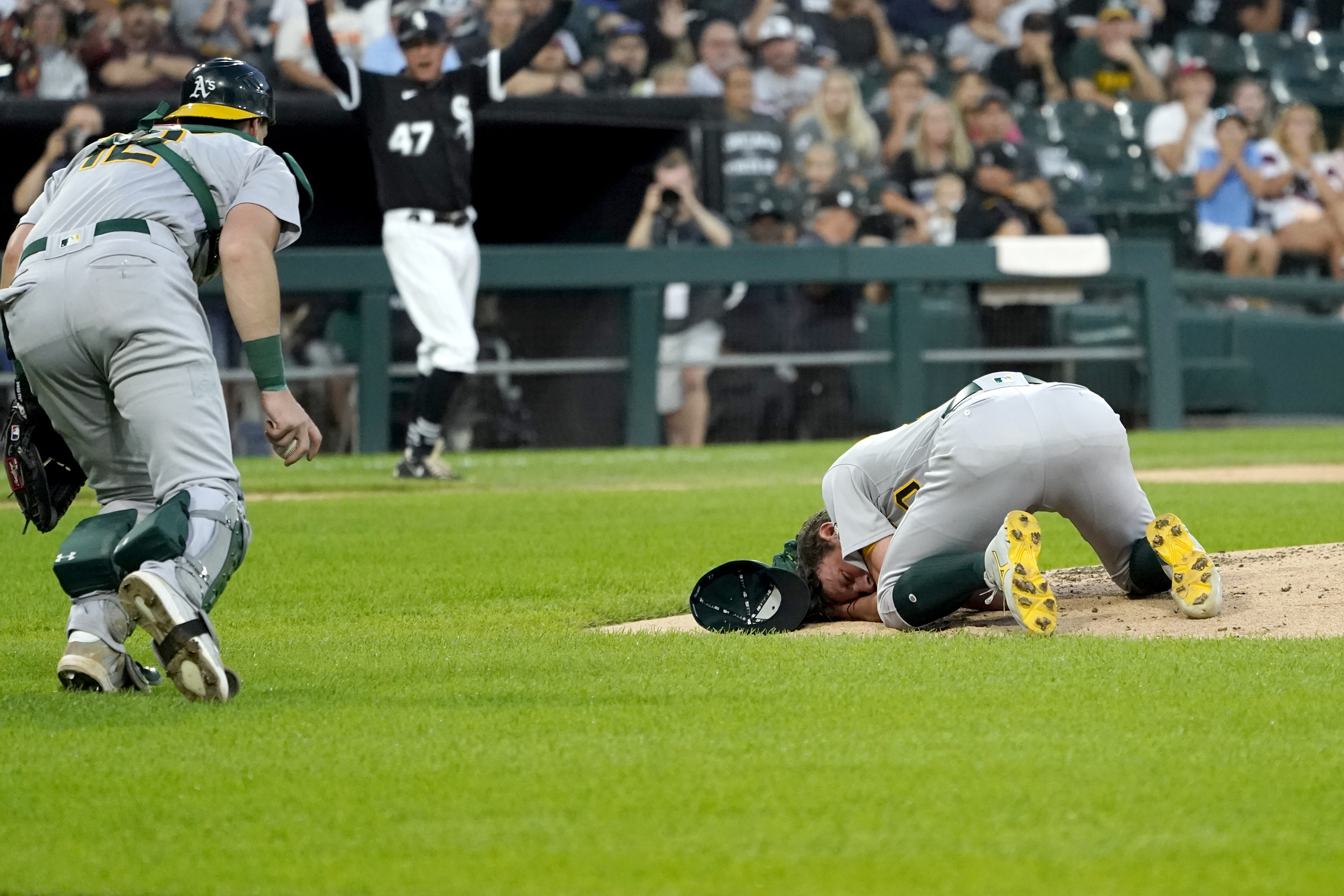 Oakland A's pitcher Chris Bassitt conscious after line drive hit him in his face, manager says