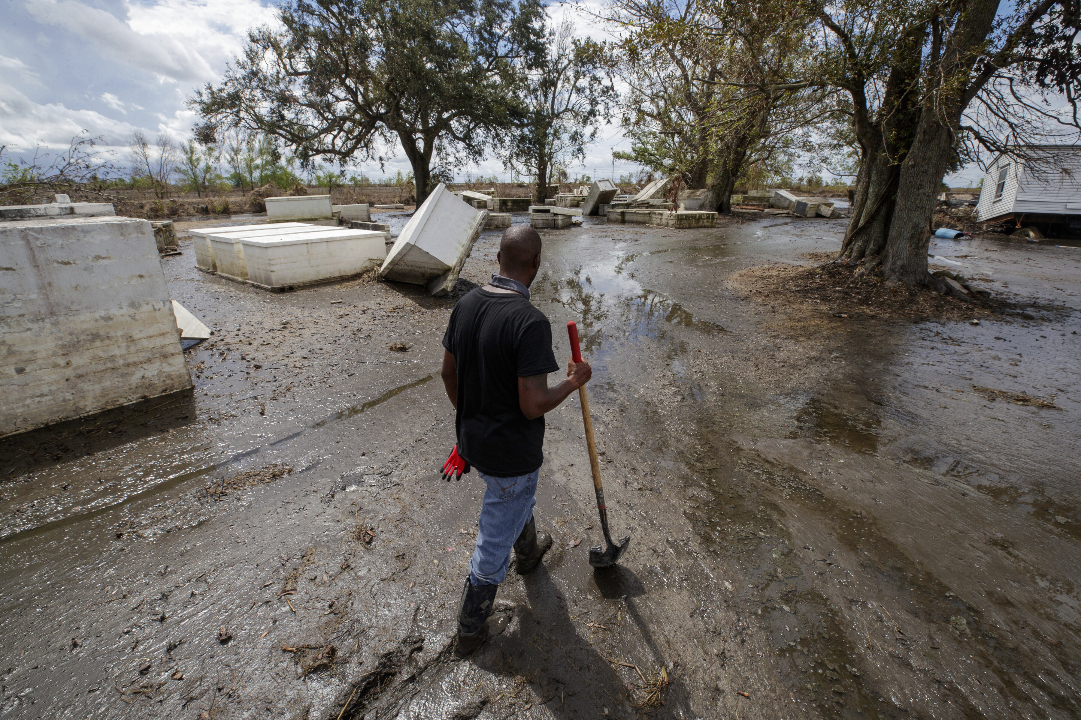 Caskets are still scattered around a Louisiana community as residents struggle to recover from Hurricane Ida