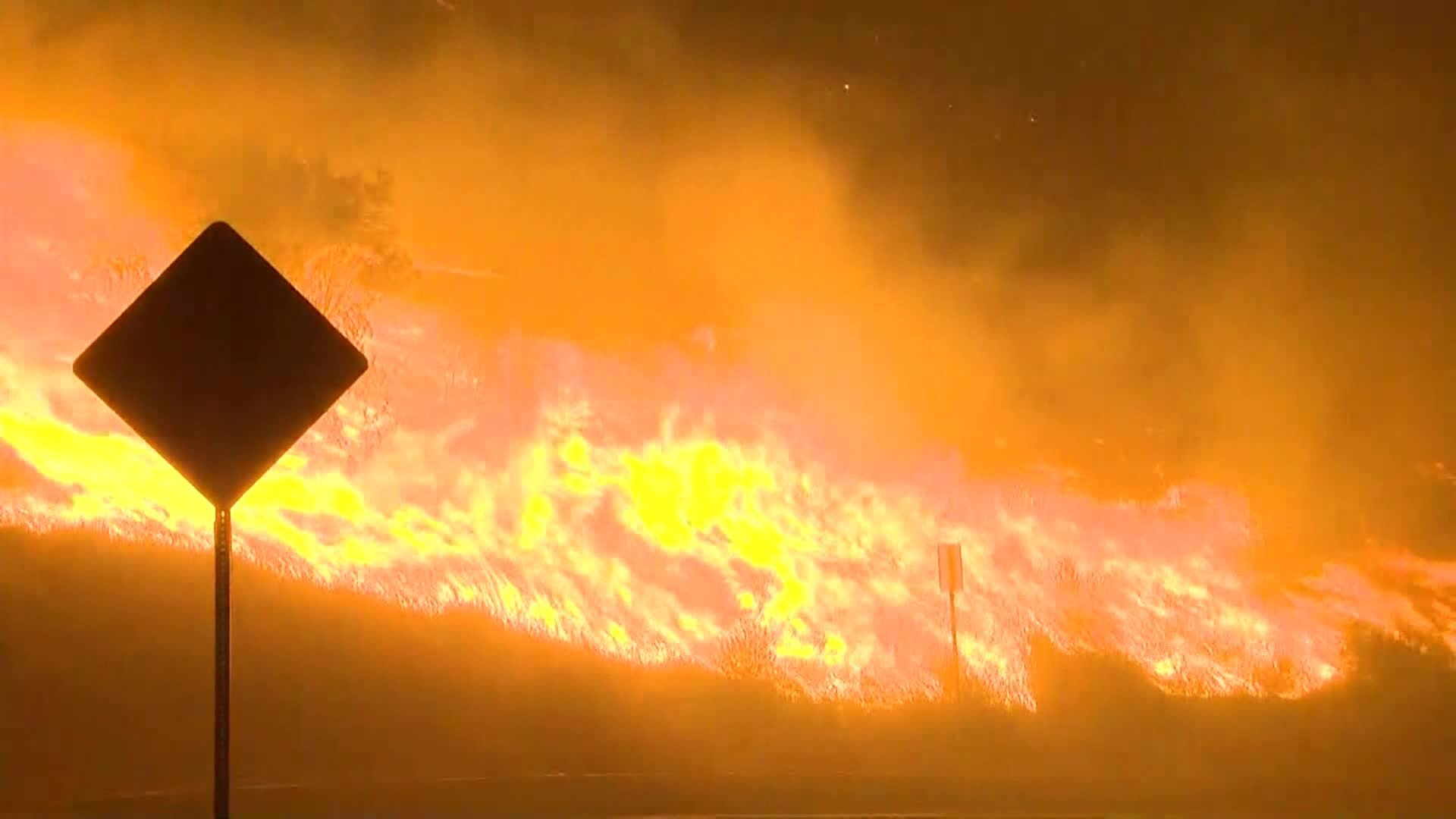 Heat records toppled as fires burn and California prepares for more power outages