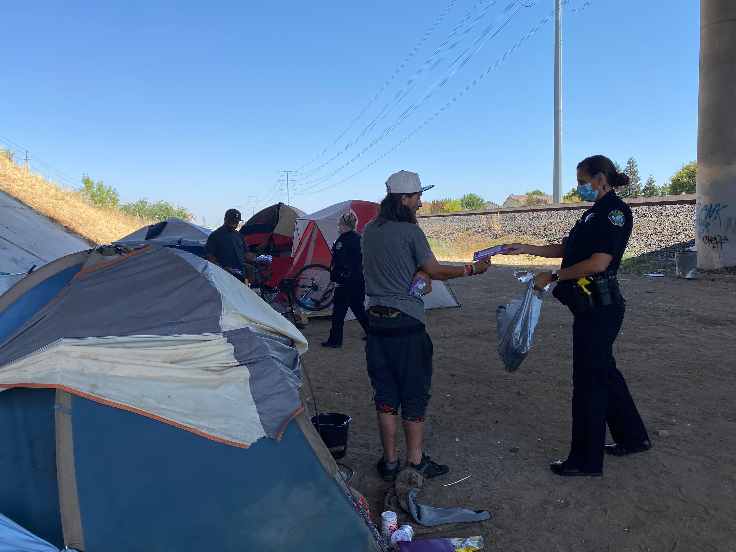 A California town is paying its homeless to clean their encampment sites