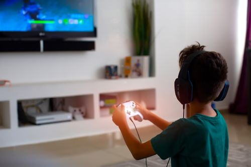 Image for Video games help children improve literacy, communication and mental well-being, survey finds