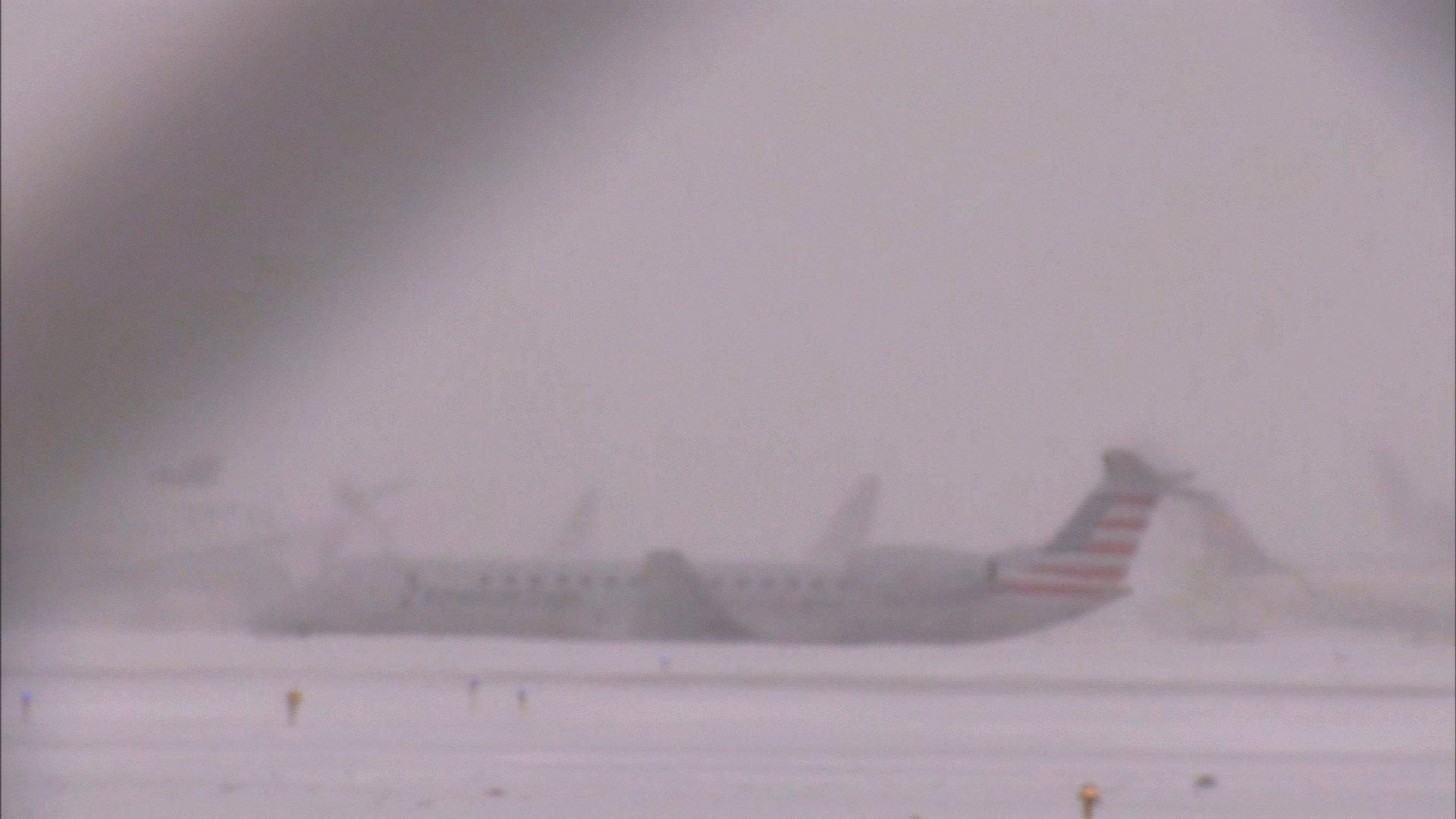 Plane slides off runway at Chicago's O'Hare as snow moves in