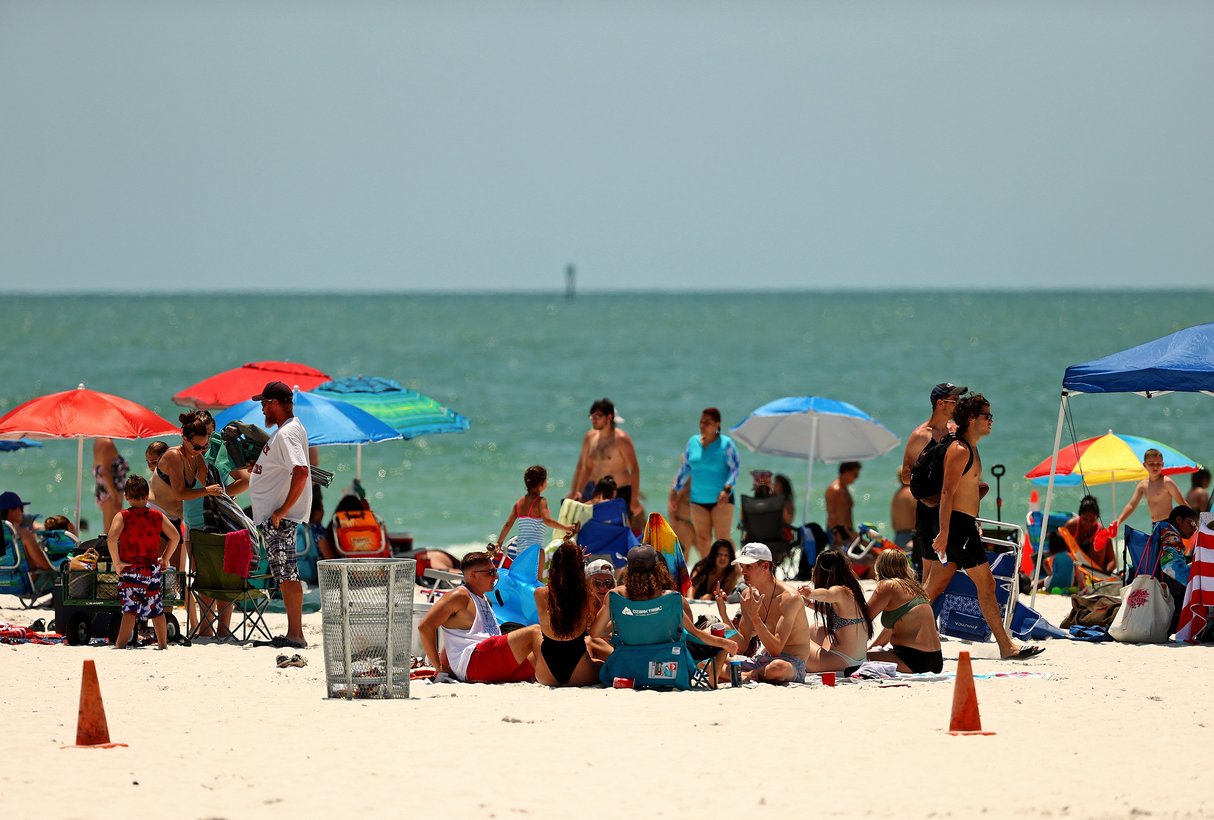 Memorial Day weekend: Americans visit beaches and attractions with pandemic warnings in mind