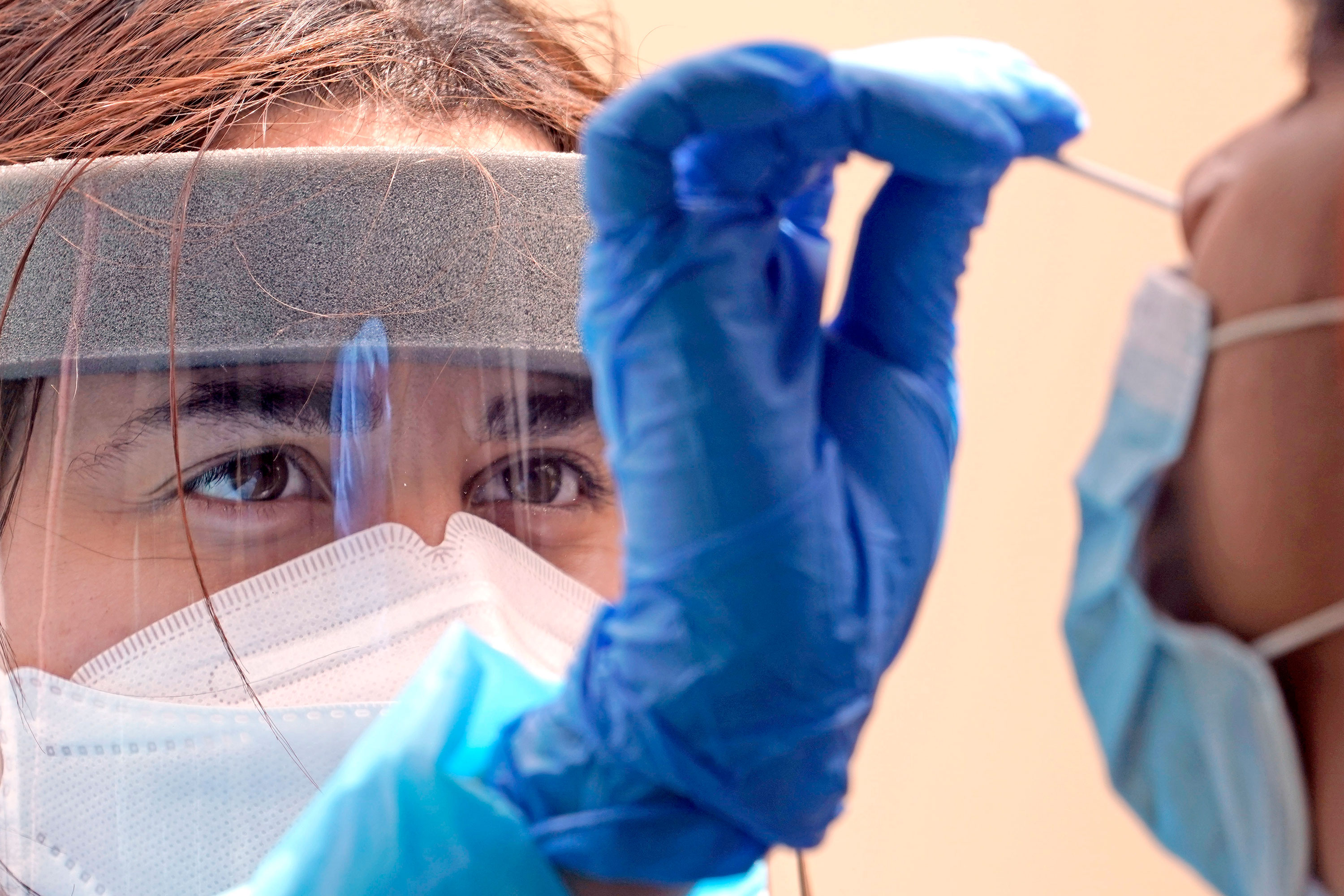 Another day of record coronavirus cases as more states rethink mask mandate