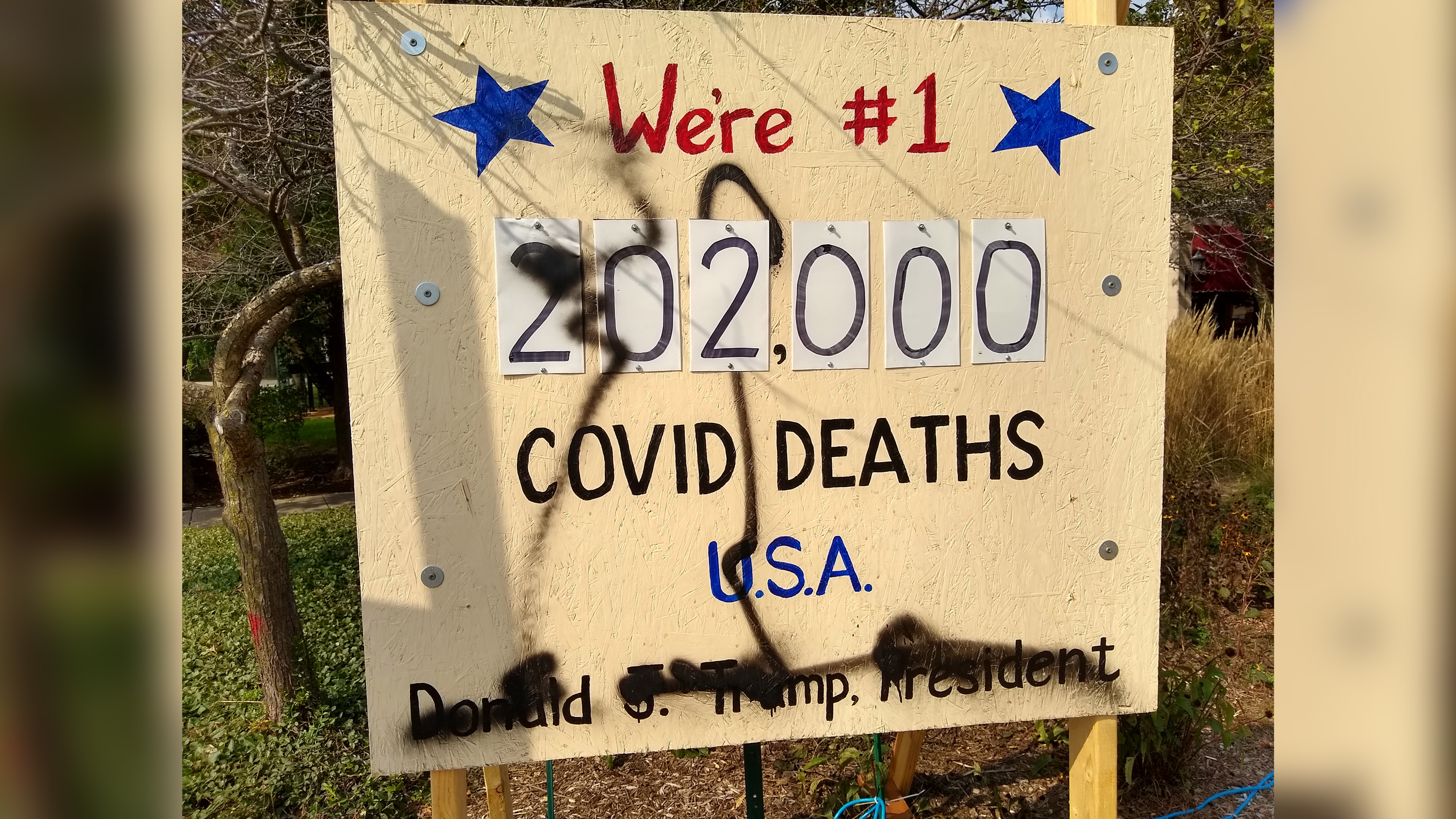 A sign reminding people of the 200,000 US Covid deaths vandalized five times in 6 days