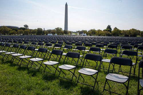 Image for Covid-19 survivors set up 20,000 empty chairs near the White House to remember the more than 200,000 coronavirus victims