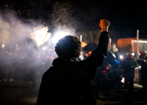 Image for At least 100 people arrested on tense sixth night of protests as Daunte Wright's loved ones mourn for his son