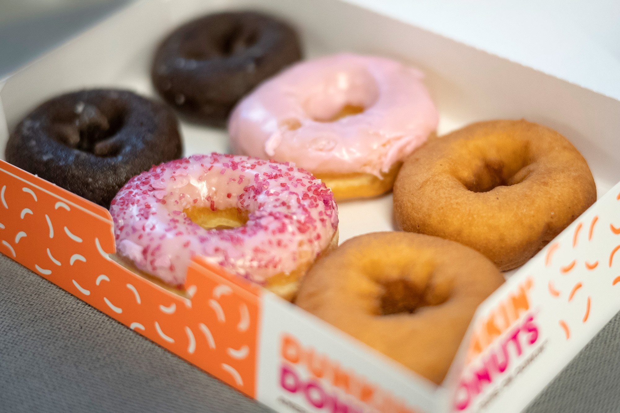 Transgender ex-cashier sues Dunkin' Donuts, saying managers let coworkers and patrons harass her, then fired her