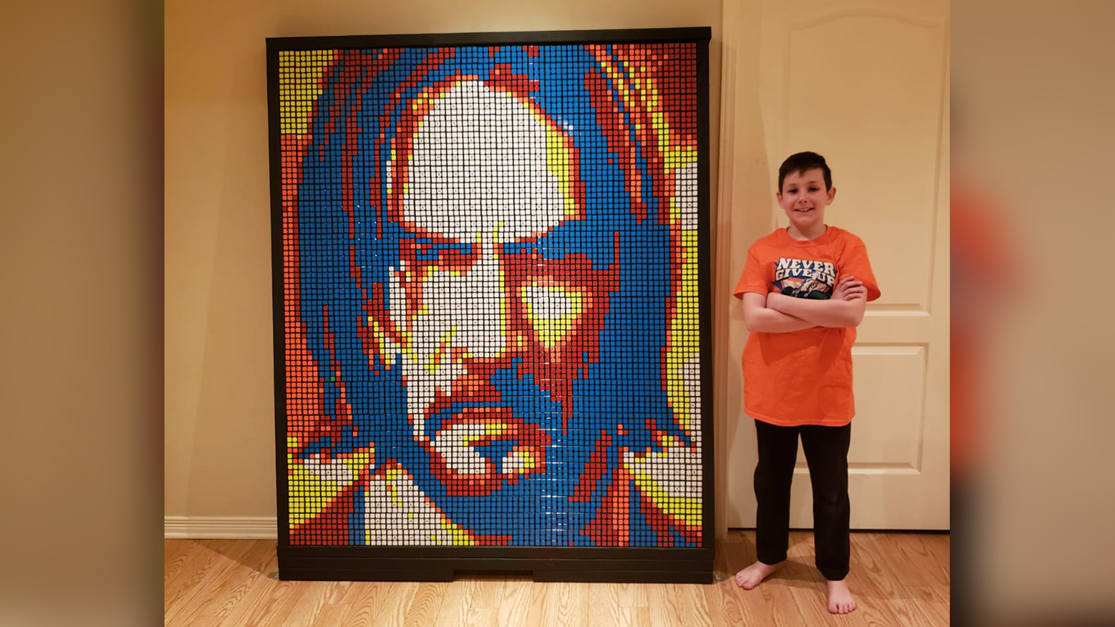 A 9-year-old created a portrait of John Cena with 750 Rubik's Cubes. His 'superpower' helped