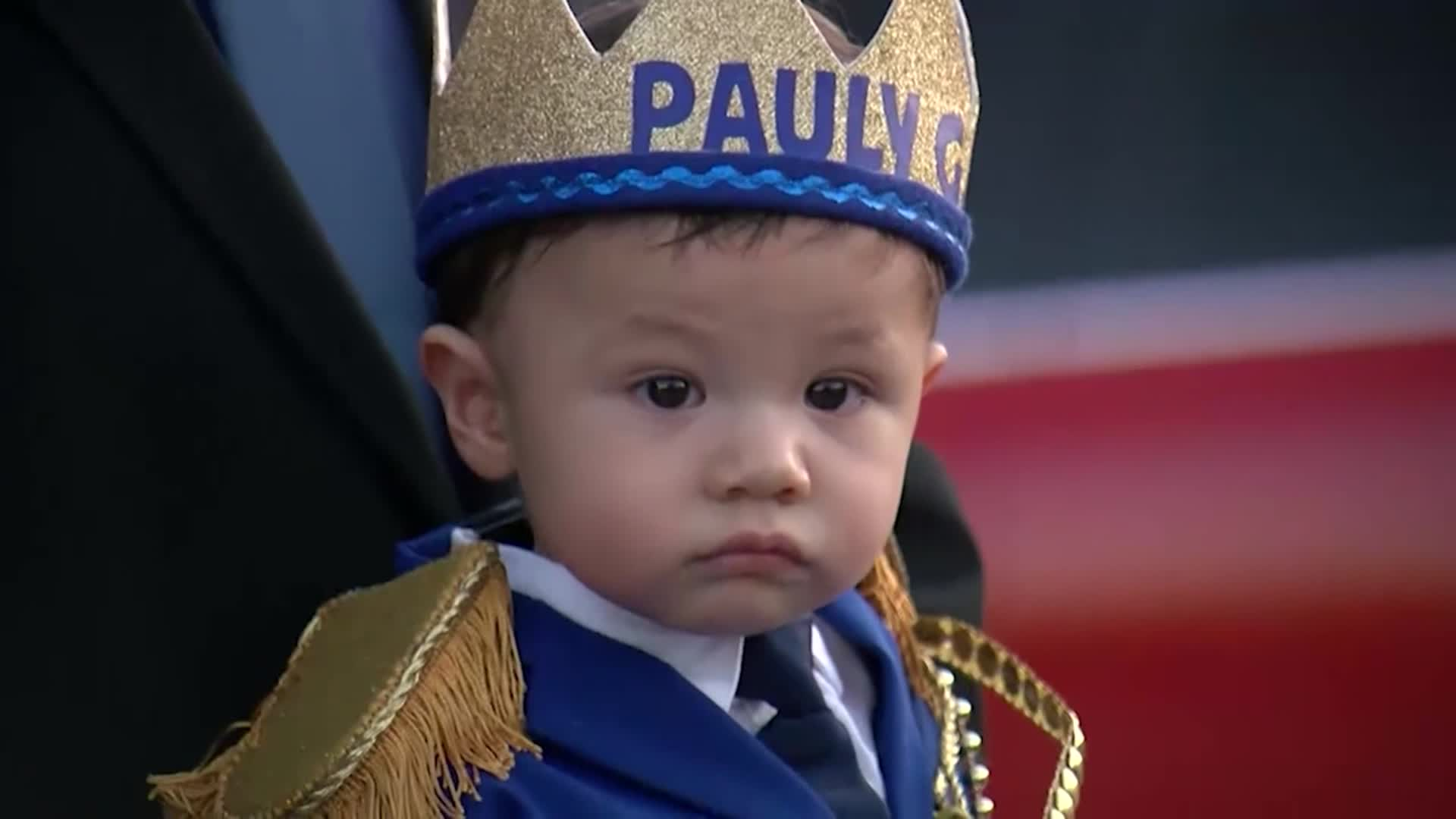 Hundreds took part in a parade celebrating the first birthday of a boy who lost both his parents in the El Paso shooting