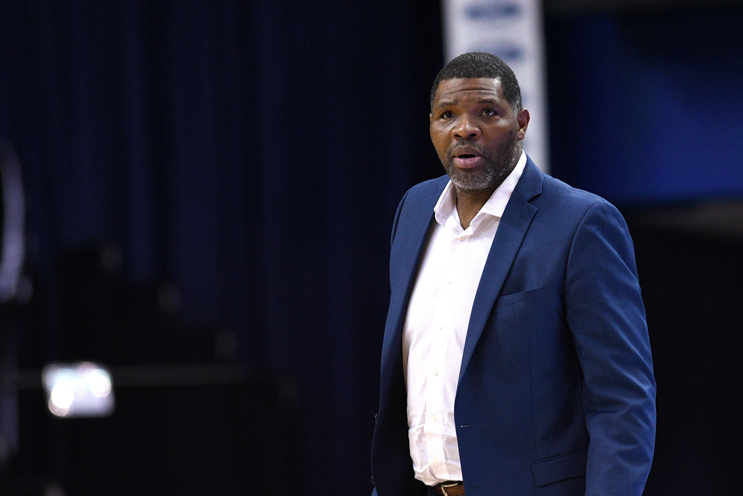 A former student sues the University of Evansville over sexual assault allegations against former basketball coach