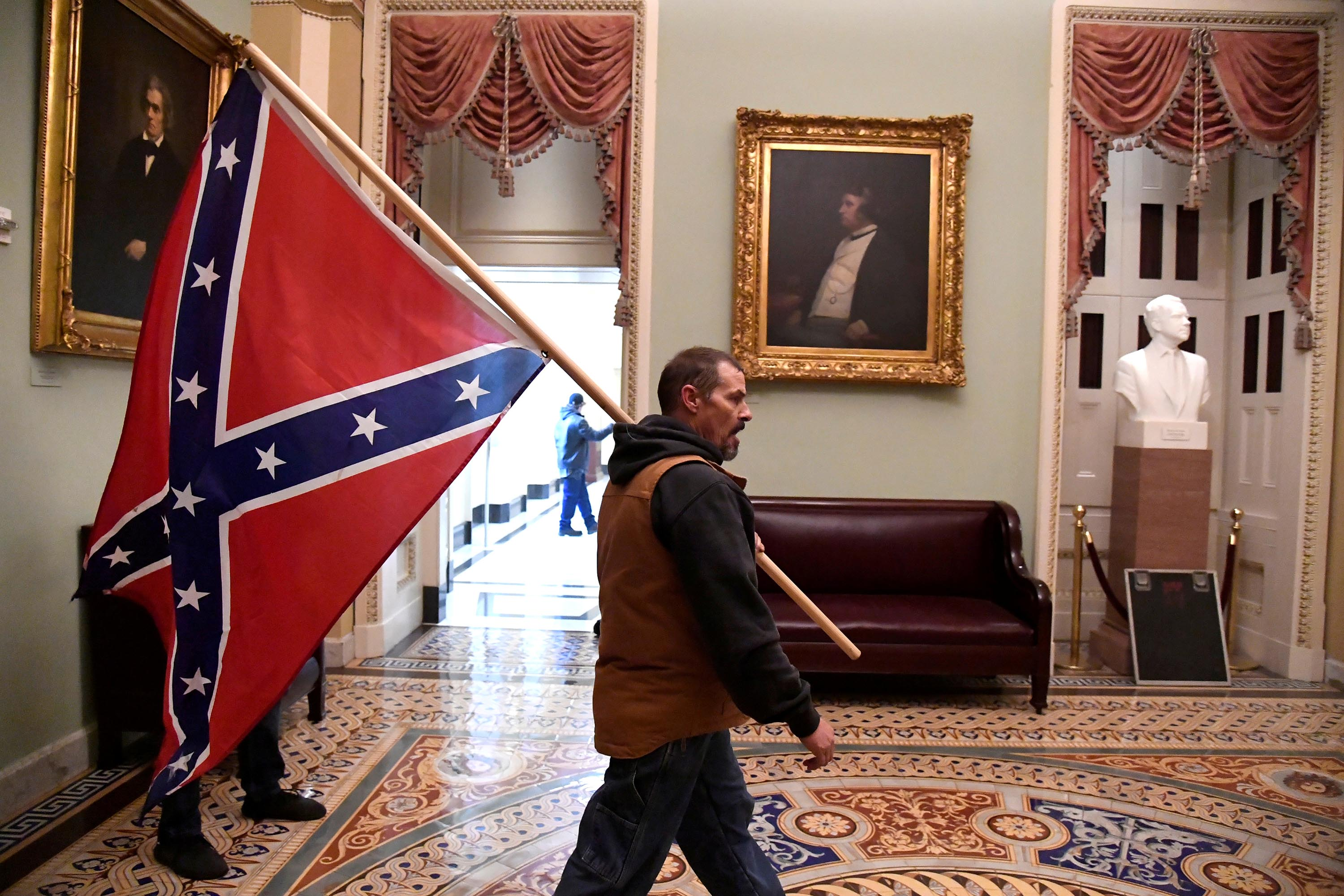 Man carrying Confederate flag inside the US Capitol during riot arrested, identified as Kevin Seefried