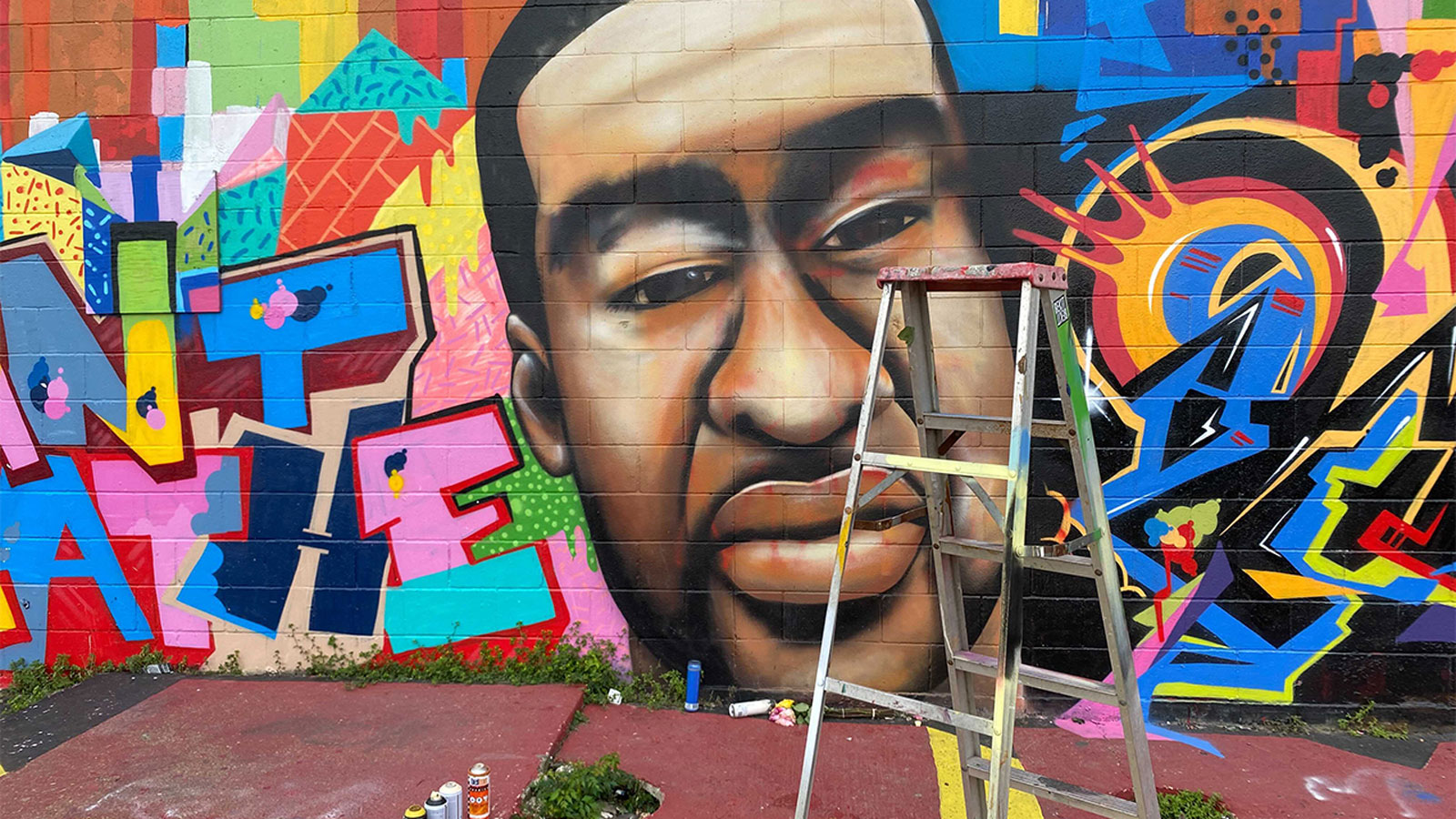 George Floyd mural in Houston defaced with a racial epithet