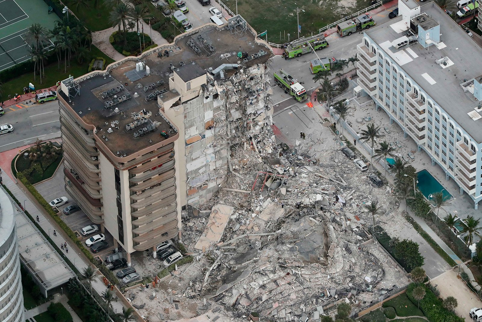 Little fingers and screaming led a dog walker to a boy trapped in the collapsed Florida condo rubble