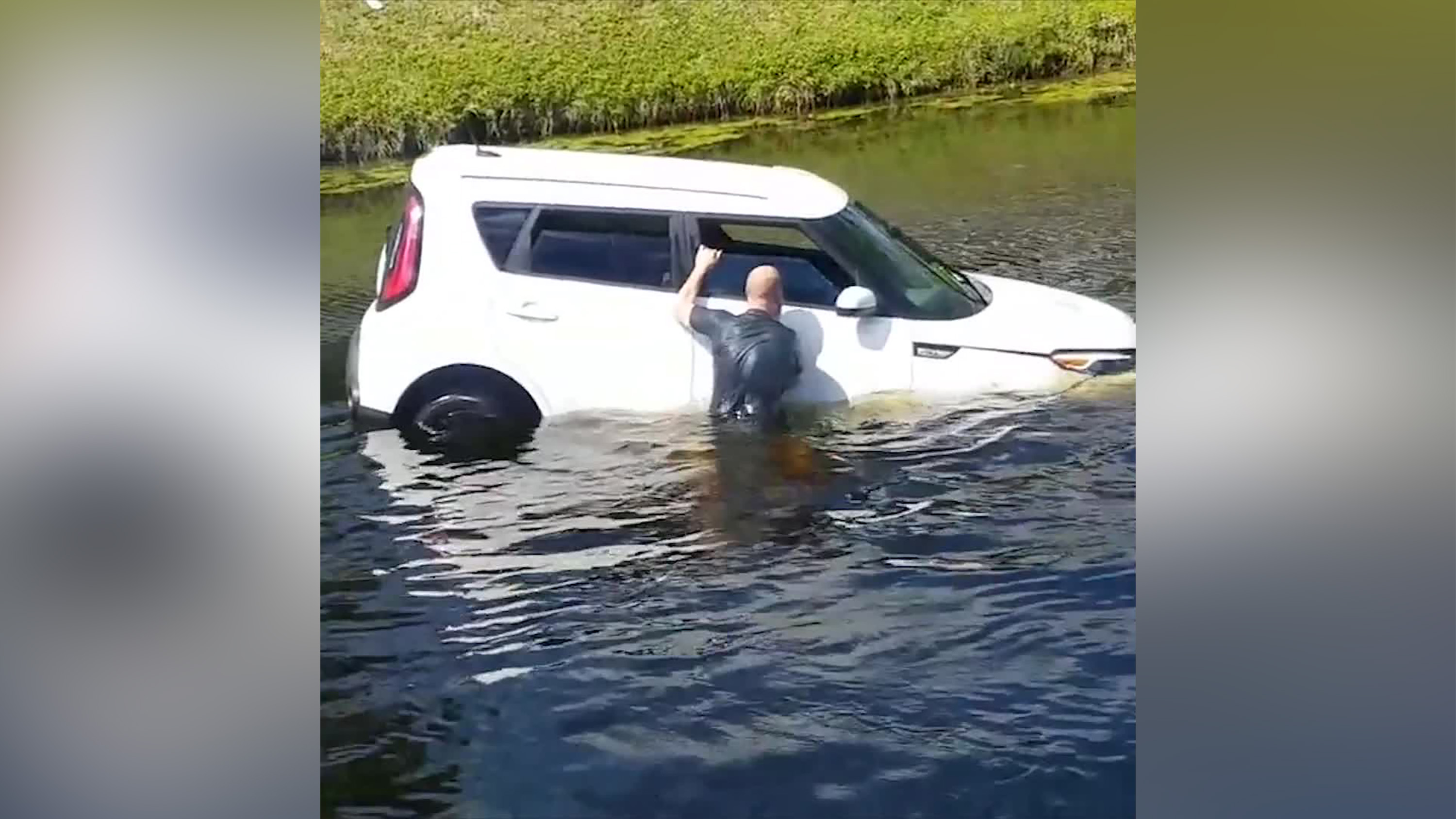 Strangers jumped into a Florida canal to rescue a woman from her sinking car