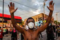 As a pandemic and protests over George Floyd's death collide, officials stress: Wear a mask