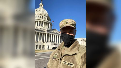 Image for National Guardsman holds music classes from the back of a Humvee while protecting the US Capitol