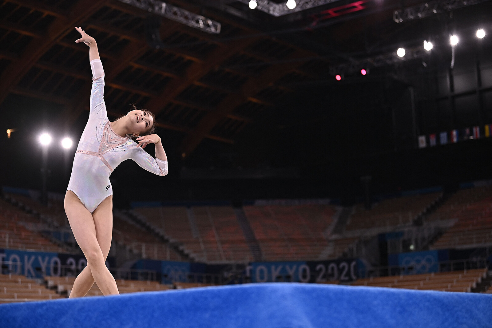 Why women gymnasts compete to music in their floor routines but men don't