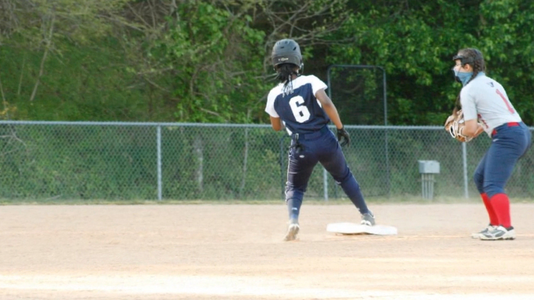 A Black softball player says she was forced to cut off her hair beads at a game. Her family wants to change the rule they say is discriminatory
