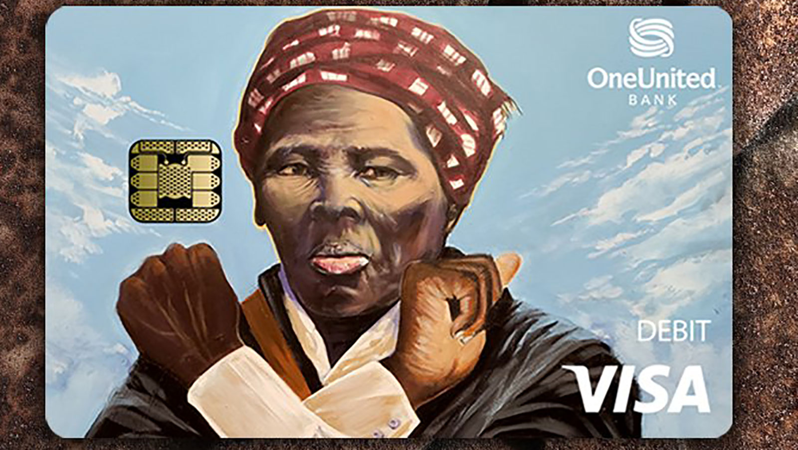 It looks like Harriet Tubman is throwing up the 'Wakanda Forever' sign on this new debit card. The bank says she's not