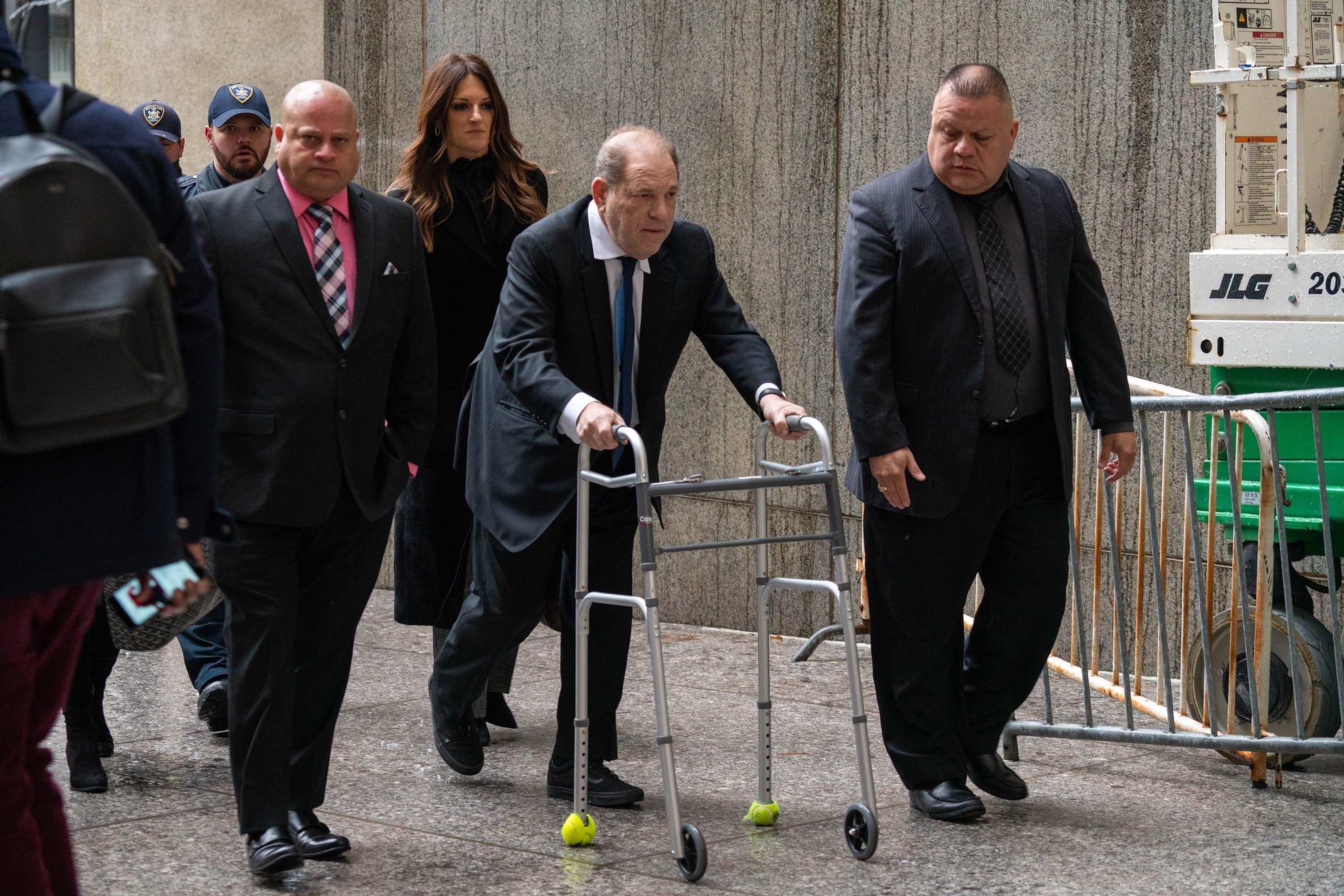 Harvey Weinstein arrives to bail hearing using a walker